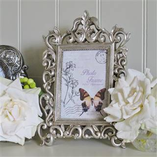 £11.99<br /><a href='/home-accessories/picture-frames/antiqued-silver-photo-frame' target='' title=''>for more details</a>