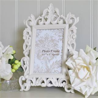 £9.99<br /><a href='/home-accessories/picture-frames/cream-ornate-photo-frame' target='' title=''>for more details</a>