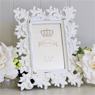 <strike>£14.99</strike> <span class='errorText'>£11.99</span><br /><a href='/home-accessories/picture-frames/ivory-ornate-photo-frame-2' target='' title=''>for more details</a>
