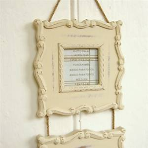 Cream hanging photo frames