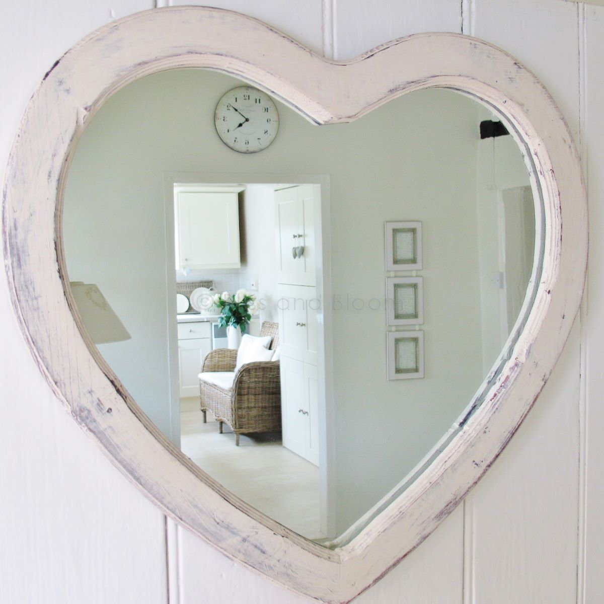 Large cream heart shaped mirror the paint work has a heavily
