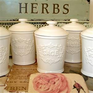 Six cream ceramic herb jars